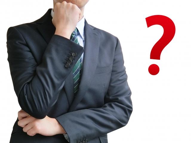 疑問に思うビジネスマン-白背景